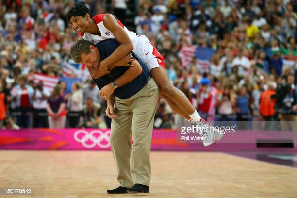 Angel McCaughtry of United States jumps on the back of head coach Geno Auriemma after the United States defeats France 8650 to win the gold medal in...