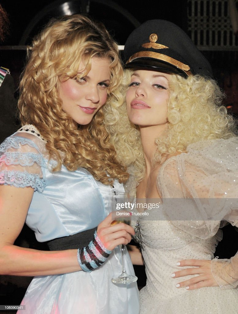 Angel McCord and AnnaLynne (R) attend Veuve Clicquot's Yelloween at Lavo Las Vegas at the Palazzo on October 30, 2010 in Las Vegas, Nevada.