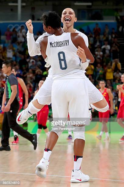 Angel Mccoughtry and Diana Taurasi of United States celebrate after winning the Women's Gold Medal Game between United States and Spain on Day 15 of...