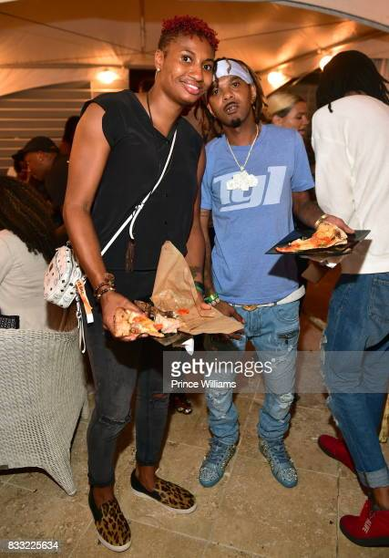 Angel McCoughtry and Lil Fate attend a Night in Little Italia Cocktail Party at Little Italia on August 11 2017 in Atlanta Georgia