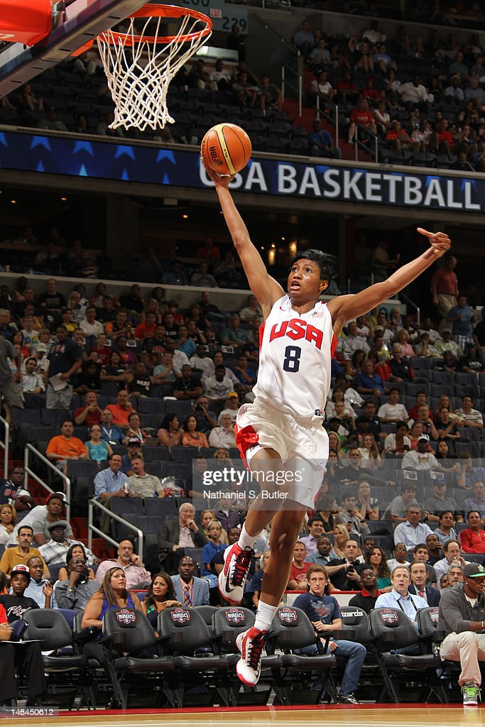 <a gi-track='captionPersonalityLinkClicked' href=/galleries/search?phrase=Angel+McCoughtry&family=editorial&specificpeople=4423621 ng-click='$event.stopPropagation()'>Angel McCoughtry</a> #8 of the 2012 US Women's Senior National Team attempts to dunk while playing against the Brazilian Women's Senior National Team at the Verizon Center on July 16, 2012 in Washington, DC.