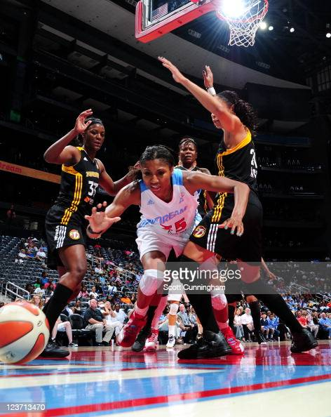 Angel McCoughtry of the Atlanta Dream battles for a loose ball against the Tulsa Shock at Philips Arena on September 4 2011 in Atlanta Georgia NOTE...
