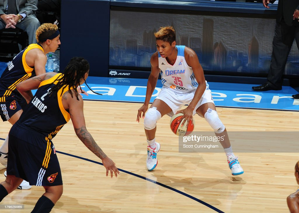 <a gi-track='captionPersonalityLinkClicked' href=/galleries/search?phrase=Angel+McCoughtry&family=editorial&specificpeople=4423621 ng-click='$event.stopPropagation()'>Angel McCoughtry</a> #35 of the Atlanta Dream dribbles against the Indiana Fever at Philips Arena on September 4 2013 in Atlanta, Georgia.