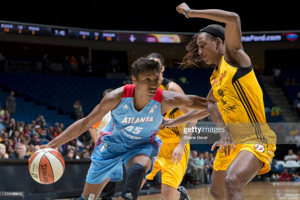 Angel McCoughtry #35 of the Atlanta Dream drives against Candice Wiggins #2 of the Tulsa Shock during the WNBA game on July 21, 2013 at the BOK Center in Tulsa, Oklahoma.