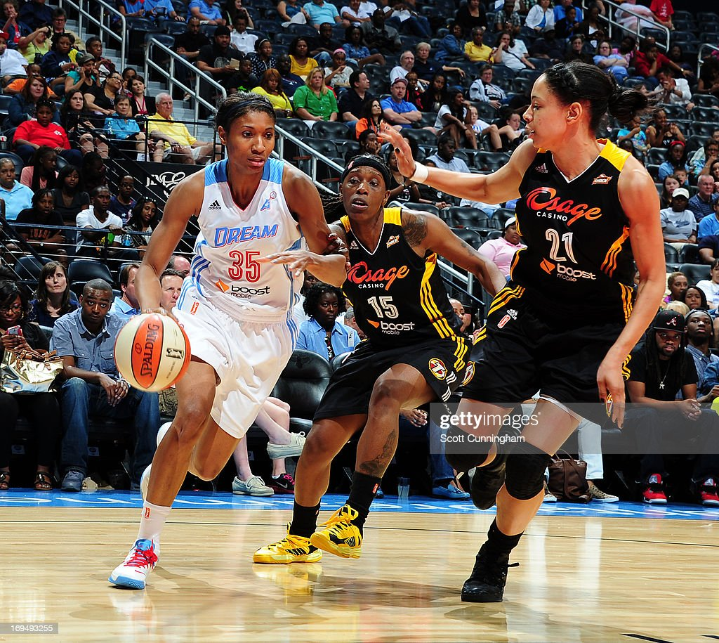 <a gi-track='captionPersonalityLinkClicked' href=/galleries/search?phrase=Angel+McCoughtry&family=editorial&specificpeople=4423621 ng-click='$event.stopPropagation()'>Angel McCoughtry</a> #35 of the Atlanta Dream drives against <a gi-track='captionPersonalityLinkClicked' href=/galleries/search?phrase=Roneeka+Hodges&family=editorial&specificpeople=233655 ng-click='$event.stopPropagation()'>Roneeka Hodges</a> #15 and Jennifer Lacy #21 of the Tulsa Shock at Philips Arena on May 25, 2013 in Atlanta, Georgia.