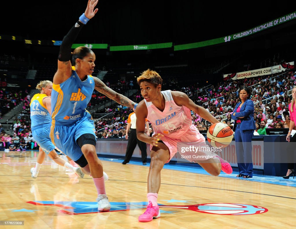 Angel McCoughtry #35 of the Atlanta Dream drives against Tamera Young #1 of the Chicago Sky at Philips Arena on August 24 2013 in Atlanta, Georgia.