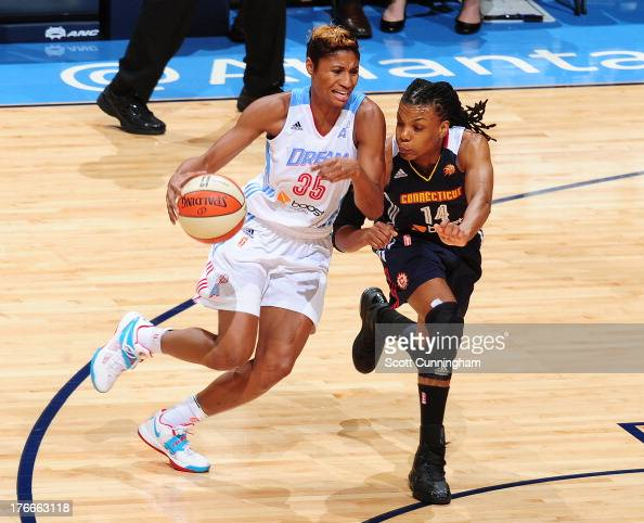 Angel McCoughtry of the Atlanta Dream drives against Tan White of the Connecticut Sun at Philips Arena on August 16 2013 in Atlanta Georgia NOTE TO...