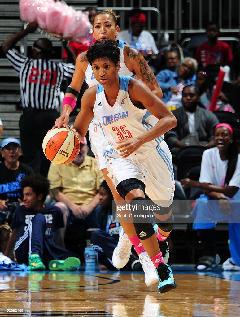 Angel McCoughtry #35 of the Atlanta Dream drives against the Connecticut Sun on July 29, 2014 at Philips Arena in Atlanta, Georgia.