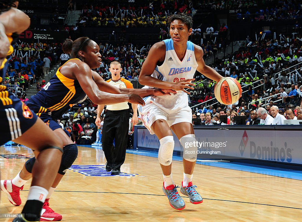<a gi-track='captionPersonalityLinkClicked' href=/galleries/search?phrase=Angel+McCoughtry&family=editorial&specificpeople=4423621 ng-click='$event.stopPropagation()'>Angel McCoughtry</a> #35 of the Atlanta Dream drives against the Indiana Fever at Philips Arena on June 25, 2013 in Atlanta, Georgia.