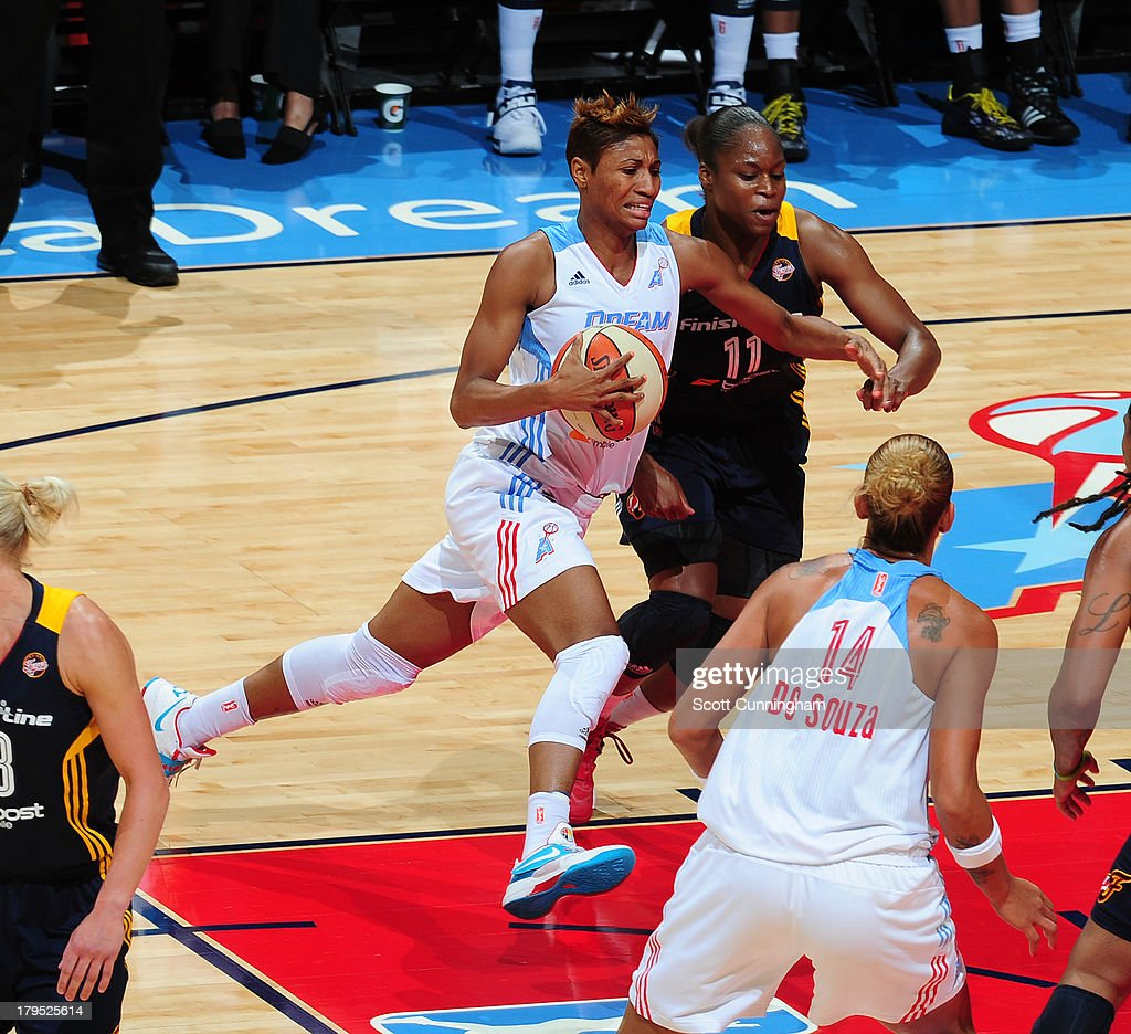 <a gi-track='captionPersonalityLinkClicked' href=/galleries/search?phrase=Angel+McCoughtry&family=editorial&specificpeople=4423621 ng-click='$event.stopPropagation()'>Angel McCoughtry</a> #35 of the Atlanta Dream drives against the Indiana Fever at Philips Arena on September 4 2013 in Atlanta, Georgia.