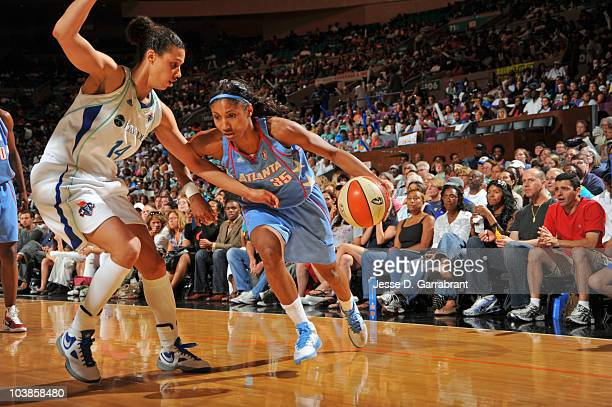 Angel McCoughtry of the Atlanta Dream drives the basketball against Nicole Powell of the New York Liberty during Game One of the 2010 WNBA Eastern...
