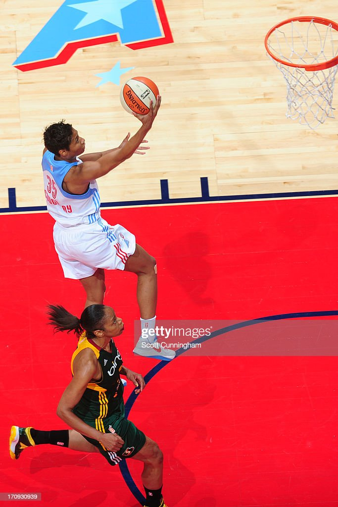 <a gi-track='captionPersonalityLinkClicked' href=/galleries/search?phrase=Angel+McCoughtry&family=editorial&specificpeople=4423621 ng-click='$event.stopPropagation()'>Angel McCoughtry</a> #35 of the Atlanta Dream drives to the basket against the Seattle Storm at Philips Arena on June 14, 2013 in Atlanta, Georgia.