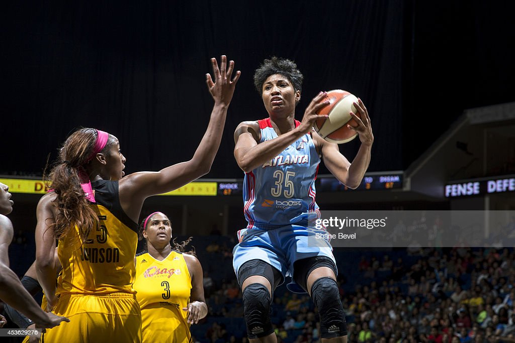 <a gi-track='captionPersonalityLinkClicked' href=/galleries/search?phrase=Angel+McCoughtry&family=editorial&specificpeople=4423621 ng-click='$event.stopPropagation()'>Angel McCoughtry</a> #35 of the Atlanta Dream drives to the basket against Glory Johnson #25 of the Tulsa Shock during the WNBA game on July 29, 2014 at the BOK Center in Tulsa, Oklahoma.