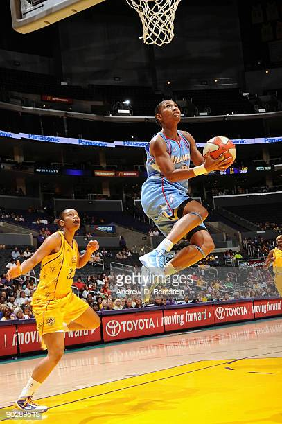 Angel McCoughtry of the Atlanta Dream goes up for a basket against Tina Thompson of the Los Angeles Sparks on September 1 2009 at Staples Center in...