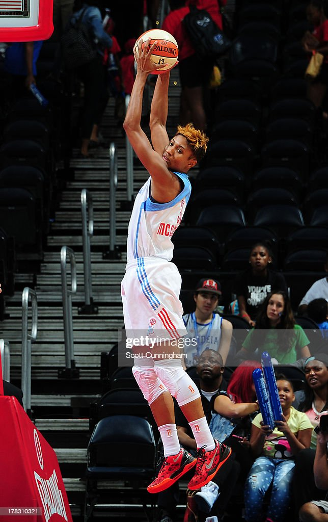 Angel McCoughtry #35 of the Atlanta Dream grabs a rebound against the Washington Mystics at Philips Arena on August 28 2013 in Atlanta, Georgia.