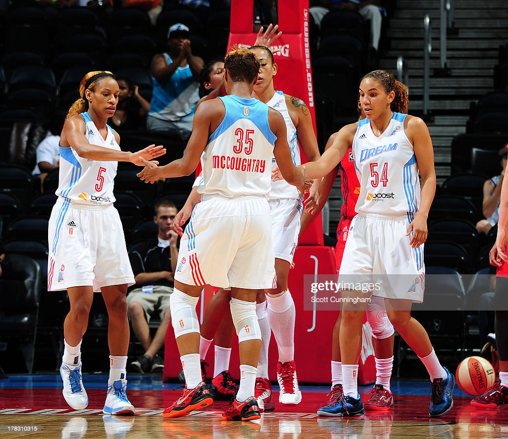 Angel McCoughtry #35 of the Atlanta Dream is congratulated by teammates after scoring against the Washington Mystics at Philips Arena on August 28 2013 in Atlanta, Georgia.