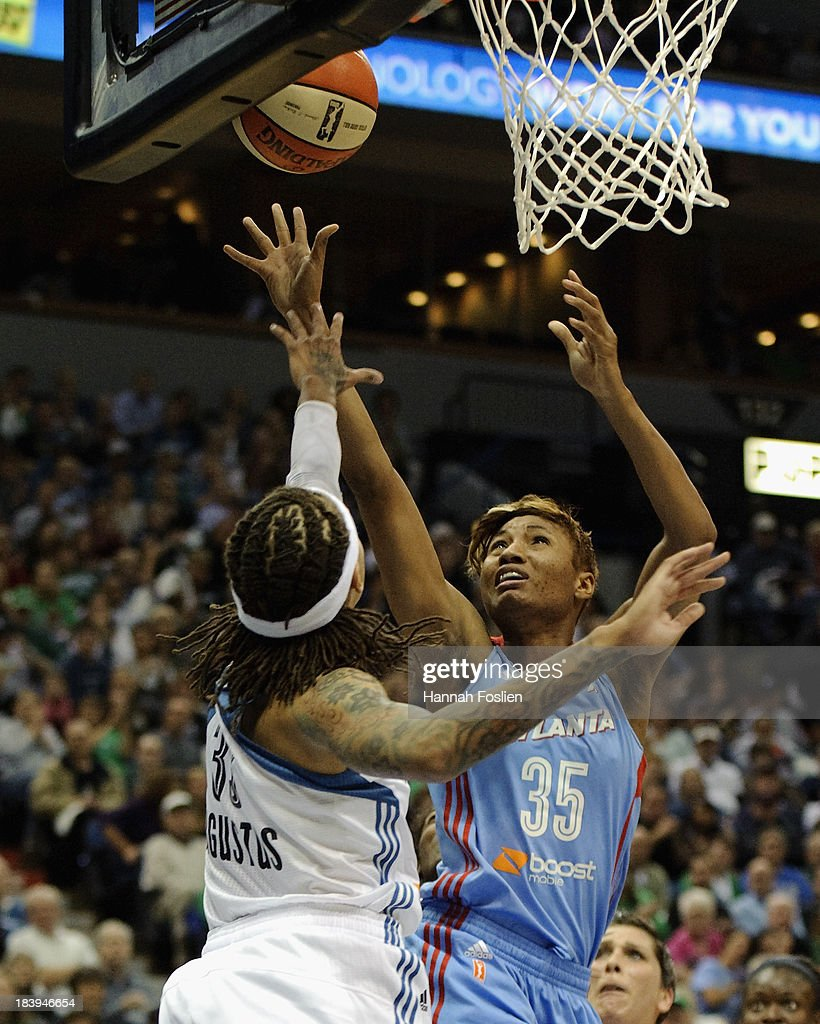 <a gi-track='captionPersonalityLinkClicked' href=/galleries/search?phrase=Angel+McCoughtry&family=editorial&specificpeople=4423621 ng-click='$event.stopPropagation()'>Angel McCoughtry</a> #35 of the Atlanta Dream makes a shot against <a gi-track='captionPersonalityLinkClicked' href=/galleries/search?phrase=Seimone+Augustus&family=editorial&specificpeople=540457 ng-click='$event.stopPropagation()'>Seimone Augustus</a> #33 of the Minnesota Lynx during Game One of the 2013 WNBA Finals on October 6, 2013 at Target Center in Minneapolis, Minnesota.