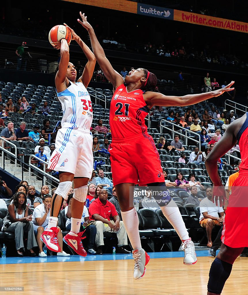 Angel McCoughtry of the Atlanta Dream puts up a shot against Nicky Anosike of the Washington Mystics at Philips Arena on September 2 2011 in Atlanta...