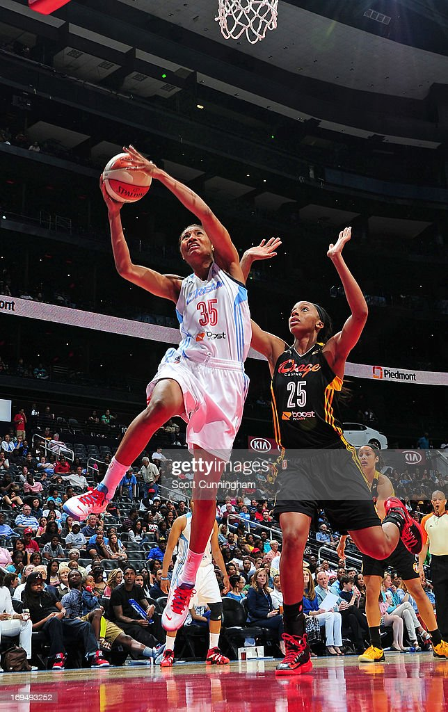 <a gi-track='captionPersonalityLinkClicked' href=/galleries/search?phrase=Angel+McCoughtry&family=editorial&specificpeople=4423621 ng-click='$event.stopPropagation()'>Angel McCoughtry</a> #35 of the Atlanta Dream puts up a shot against the Tulsa Shock at Philips Arena on May 25, 2013 in Atlanta, Georgia.