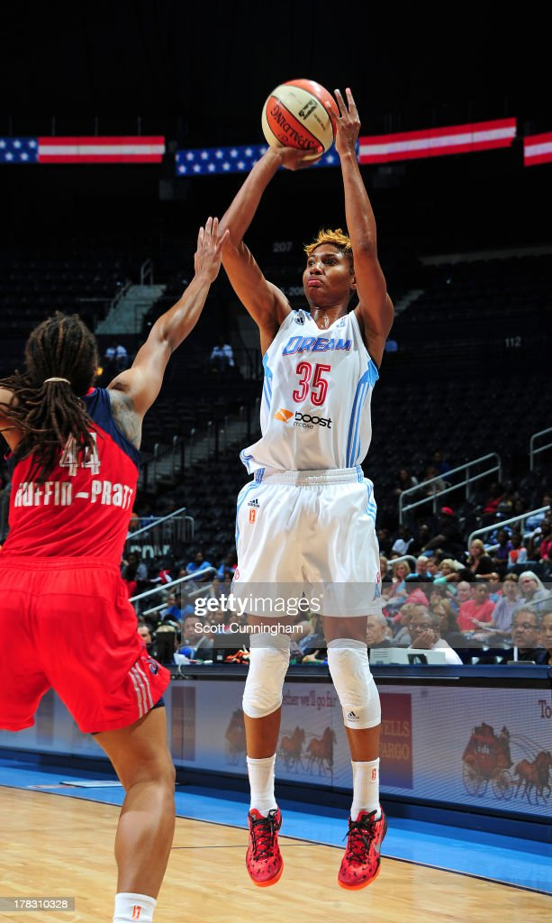 <a gi-track='captionPersonalityLinkClicked' href=/galleries/search?phrase=Angel+McCoughtry&family=editorial&specificpeople=4423621 ng-click='$event.stopPropagation()'>Angel McCoughtry</a> #35 of the Atlanta Dream puts up a shot against the Washington Mystics at Philips Arena on August 28 2013 in Atlanta, Georgia.