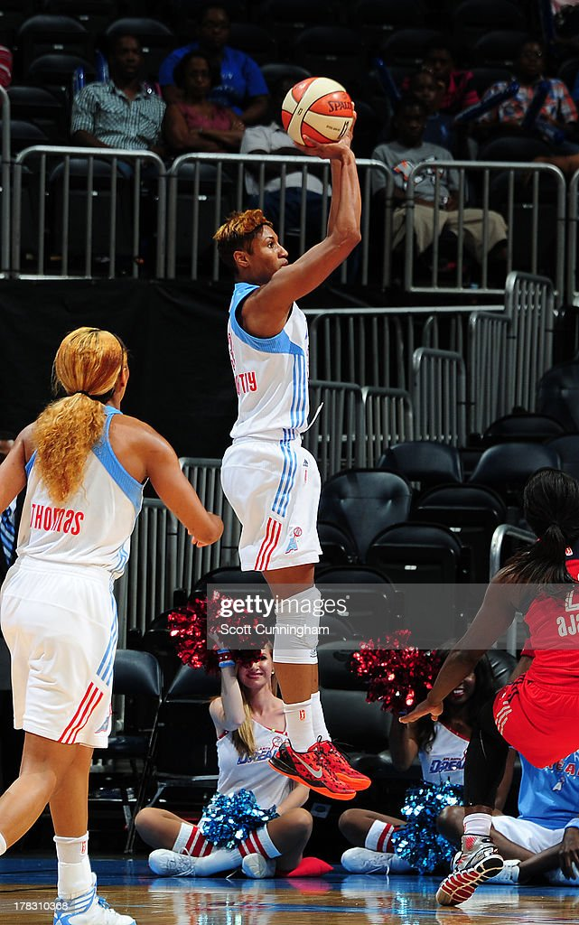 Angel McCoughtry #35 of the Atlanta Dream puts up a shot against the Washington Mystics at Philips Arena on August 28 2013 in Atlanta, Georgia.