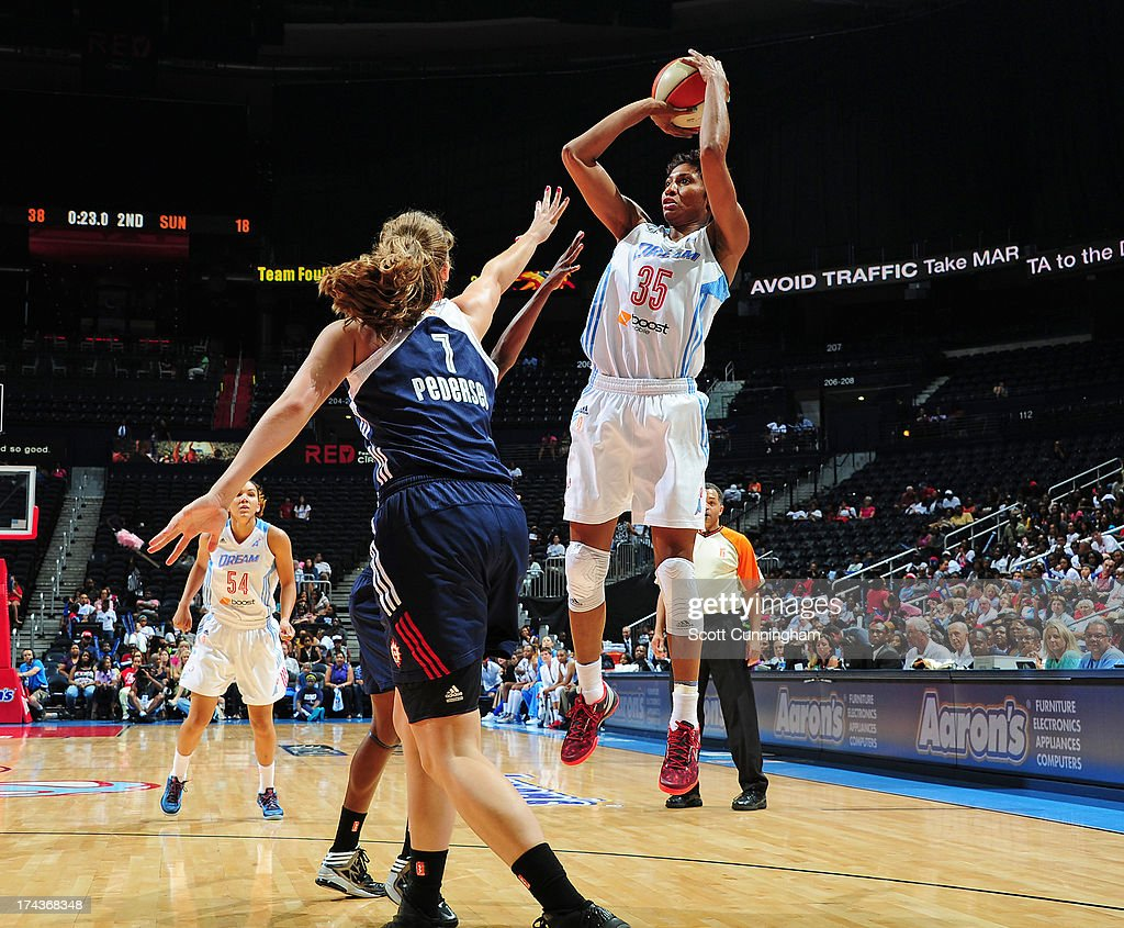 Angel McCoughtry #35 of the Atlanta Dream puts up a shot against the Connecticut Sun at Philips Arena on July 24, 2013 in Atlanta, Georgia.