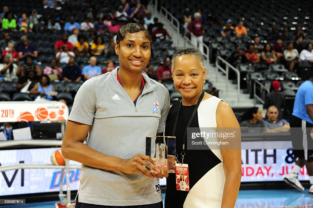 <a gi-track='captionPersonalityLinkClicked' href=/galleries/search?phrase=Angel+McCoughtry&family=editorial&specificpeople=4423621 ng-click='$event.stopPropagation()'>Angel McCoughtry</a> #35 of the Atlanta Dream receives an award from WNBA President <a gi-track='captionPersonalityLinkClicked' href=/galleries/search?phrase=Lisa+Borders&family=editorial&specificpeople=4578856 ng-click='$event.stopPropagation()'>Lisa Borders</a> before the game against the Indiana Fever on May 29, 2016 at Philips Arena in Atlanta, Georgia.