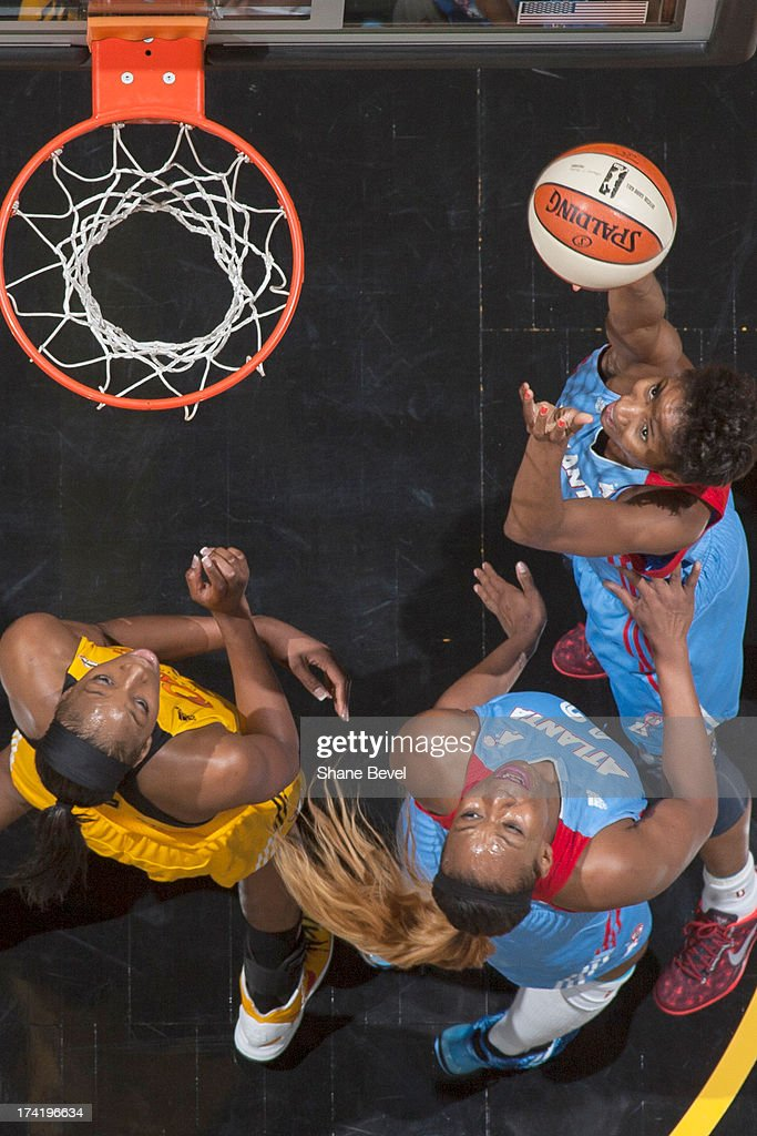 <a gi-track='captionPersonalityLinkClicked' href=/galleries/search?phrase=Angel+McCoughtry&family=editorial&specificpeople=4423621 ng-click='$event.stopPropagation()'>Angel McCoughtry</a> #35 of the Atlanta Dream shoots against Glory Johnson #25 of the Tulsa Shock during the WNBA game on July 21, 2013 at the BOK Center in Tulsa, Oklahoma.