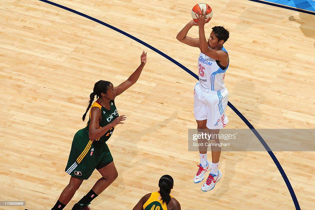 <a gi-track='captionPersonalityLinkClicked' href=/galleries/search?phrase=Angel+McCoughtry&family=editorial&specificpeople=4423621 ng-click='$event.stopPropagation()'>Angel McCoughtry</a> #35 of the Atlanta Dream shoots against the Seattle Storm at Philips Arena on June 14, 2013 in Atlanta, Georgia.