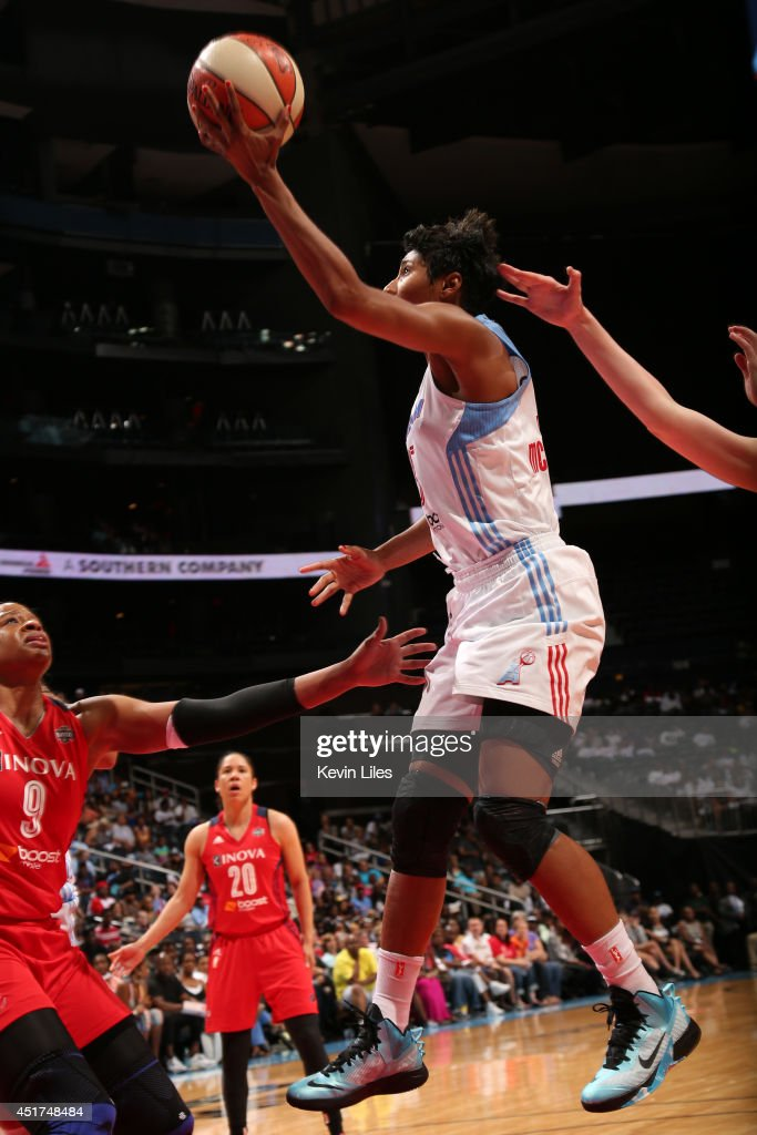 Angel McCoughtry #35 of the Atlanta Dream takes a shot against the Washington Mystics at Philips Arena on July 5, 2014 in Atlanta, Georgia.