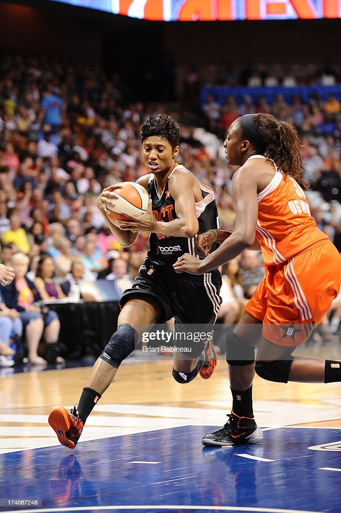 Angel McCoughtry #35 of the Eastern Conference All-Stars drives to the basket against Nneka Ogwumike #30 of the Western Conference All-Stars during the 2013 Boost Mobile WNBA All-Star Game on July 27, 2013 at Mohegan Sun Arena in Uncasville, Connecticut.