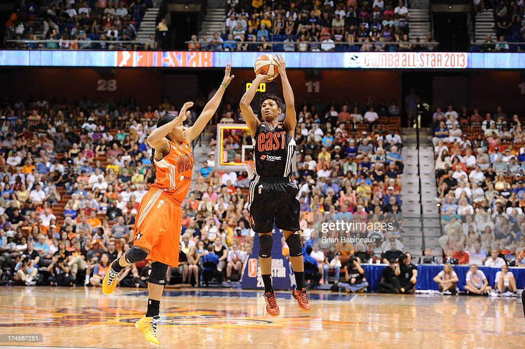 Angel McCoughtry #35 of the Eastern Conference All-Stars shoots against Maya Moore #23 of the Western Conference All-Stars during the 2013 Boost Mobile WNBA All-Star Game on July 27, 2013 at Mohegan Sun Arena in Uncasville, Connecticut.