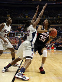 Angel McCoughtry of the Louisville Cardinals heads for the net as Kalana Greene of the Connecticut Huskies defends on April 7 2009 during the NCAA...