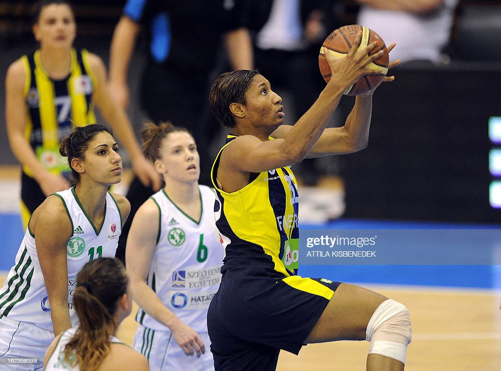 US Angel McCoughtry (R) of the Turkish Fenerbahce Istanbul scores a basket against Hungarian Hat-Agro UNI Gyor in Gyor on February 22, 2013 during their EuroLeague match. Turkish team won 77-68. AFP PHOTO / ATTILA KISBENEDEK