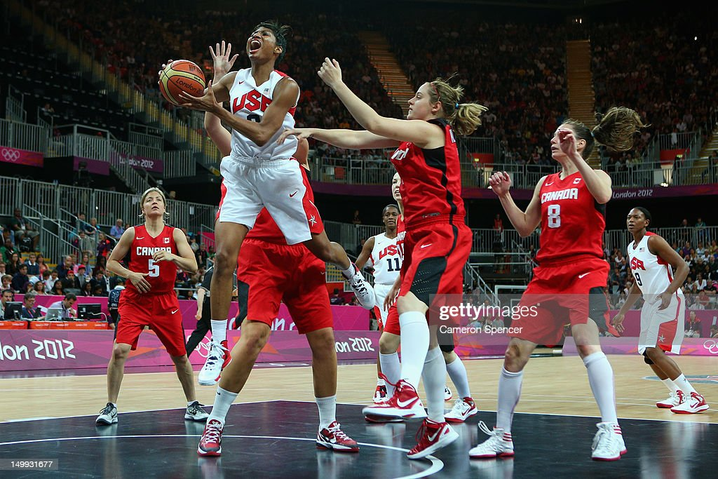 <a gi-track='captionPersonalityLinkClicked' href=/galleries/search?phrase=Angel+McCoughtry&family=editorial&specificpeople=4423621 ng-click='$event.stopPropagation()'>Angel McCoughtry</a> of the United States lays the ball up during the Women's Basketball quaterfinal between Canada and the United States on Day 11 of the London 2012 Olympic Games at the Basketball Arena on August 7, 2012 in London, England.