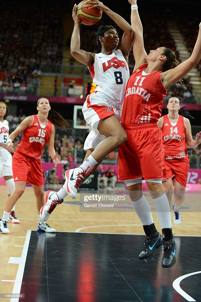 <a gi-track='captionPersonalityLinkClicked' href=/galleries/search?phrase=Angel+McCoughtry&family=editorial&specificpeople=4423621 ng-click='$event.stopPropagation()'>Angel McCoughtry</a> #8 of the United States shoots versus Croatia at the Olympic Park Basketball Arena during the London Olympic Games on July 28, 2012 in London, England.