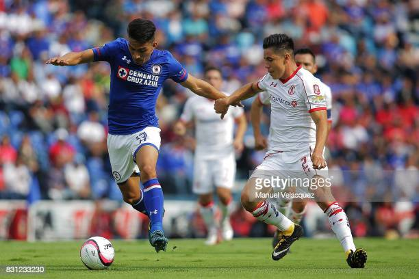 Angel Mena of Cruz Azul struggles for the ball against Efrain Velarde of Toluca during the 4th round match between Cruz Azul and Chivas as part of...
