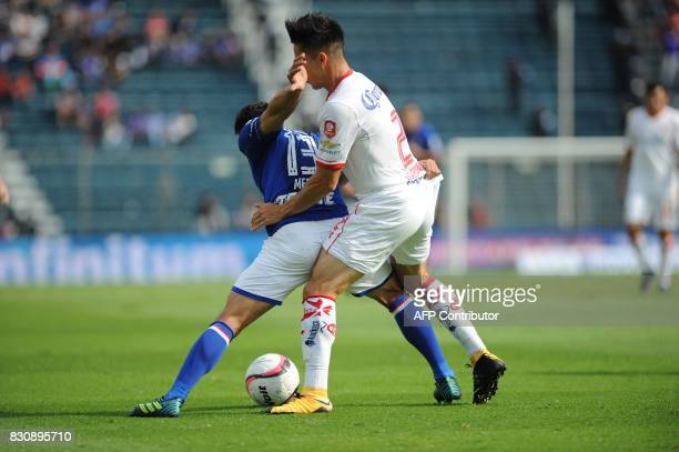 Angel Mena of Cruz Azul vies for the ball with Efrain Velarde of Toluca during their Mexican Torneo Apertura 2017 football match at Azul Stadium in...