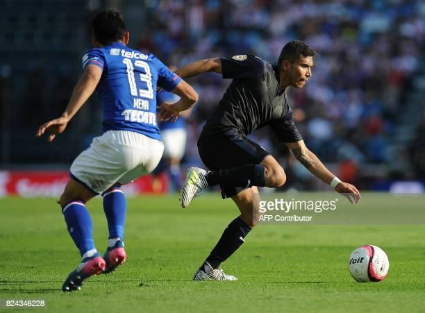 Angel Mena of Cruz Azul vies for the ball with Orbelin Pineda of Guadalajara as part of the Torneo Apertura 2017 Liga MX at Azul Stadium on July 29...