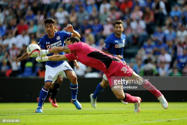 Angel Mena of Cruz Azul vies for the ball with Rodolfo Cota goalkeeper of Guadalajara as part of the Torneo Apertura 2017 Liga MX at Azul Stadium on...