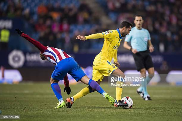 Angel Montoro Sanchez of UD Las Palmas runs the ball past Antoine Griezmann of Atletico de Madrid during their Copa del Rey 201617 Round of 16 match...