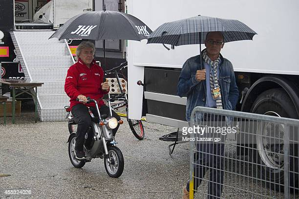 Angel Nieto of Spain rides the scooter with umbrella in paddock during the MotoGP of San Marino Free Practice at Misano World Circuit on September 12...