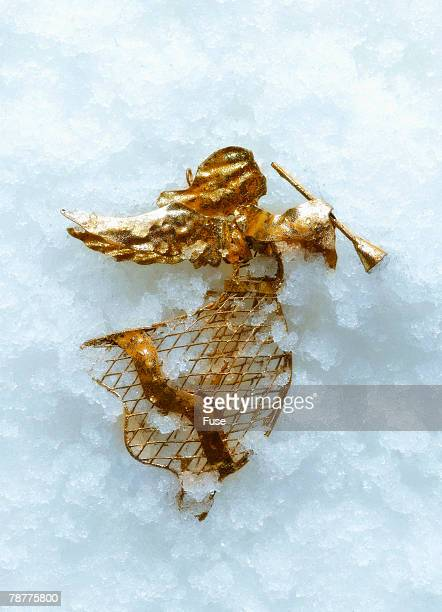 Angel Ornament Lying in Snow
