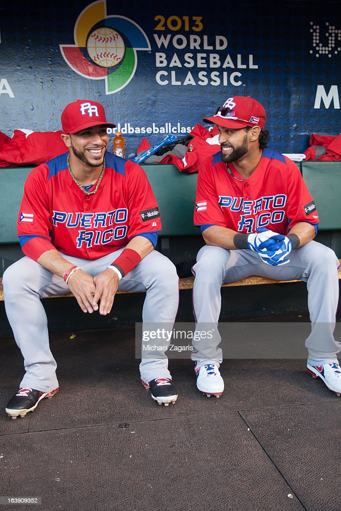Angel Pagan #16 and Mike Aviles #14 of Team Puerto Rico talk in the dugout before the semi-final game against Team Japan in the championship round of the 2013 World Baseball Classic on Sunday, March 17, 2013 at AT&T Park in San Francisco, California.