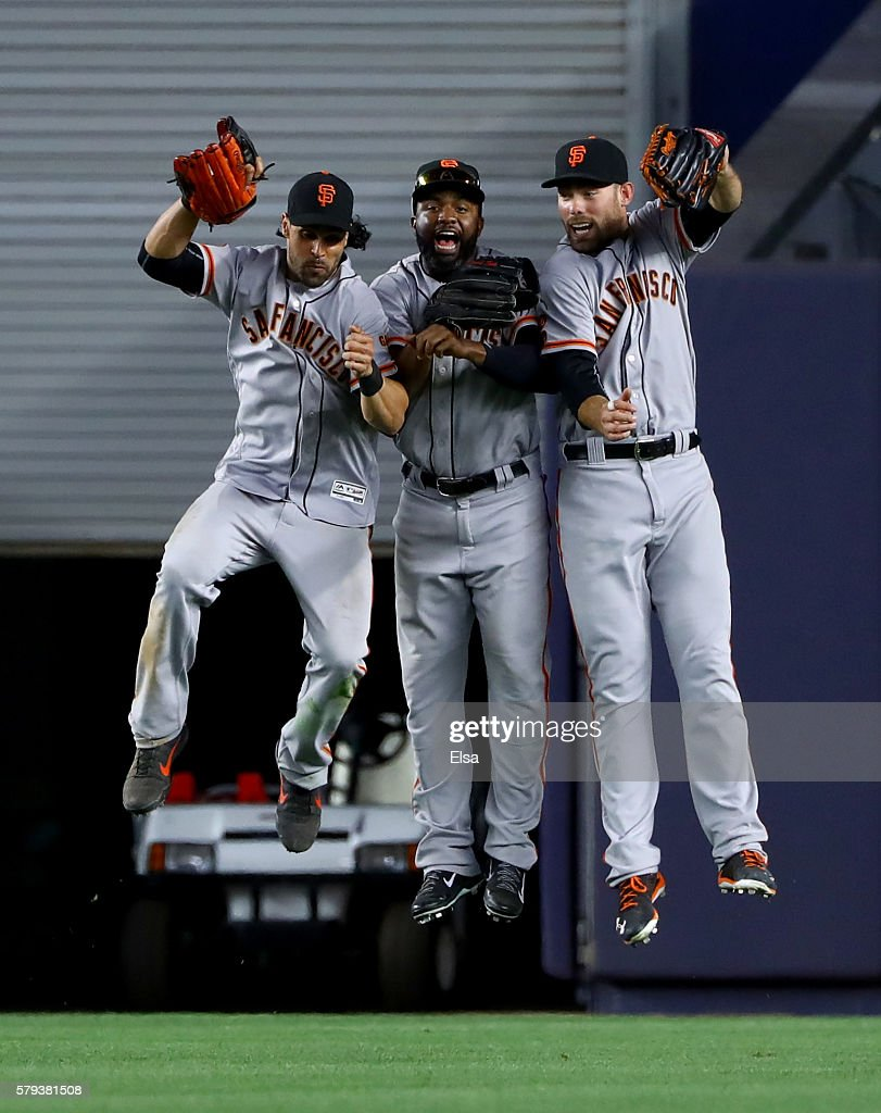 Angel Pagan #16, Denard Span #2 and Mac Williamson #51 of the San Francisco Giants celebate the win over the New York Yankees on July 23, 2016 at Yankee Stadium in the Bronx borough of New York City.The San Francisco Giants defeated the New York Yankees 2-1 in 12 innings.