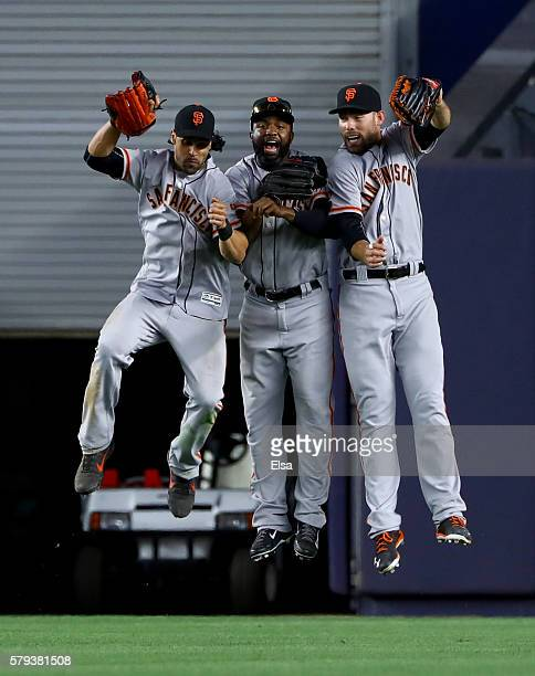 Angel Pagan Denard Span and Mac Williamson of the San Francisco Giants celebate the win over the New York Yankees on July 23 2016 at Yankee Stadium...