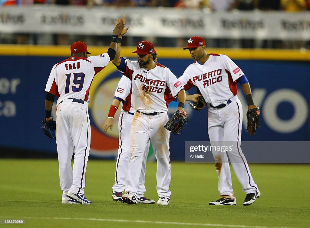 Angel Pagan #16 of Puerto Rico celebrates a 3-0 win against Spain with teamates during the first round of the World Baseball Classic at Hiram Bithorn Stadium on March 8, 2013 in San Juan, Puerto Rico.