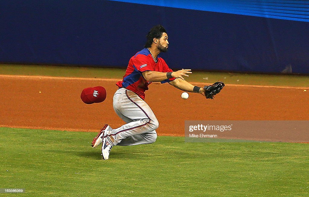 <a gi-track='captionPersonalityLinkClicked' href=/galleries/search?phrase=Angel+Pagan&family=editorial&specificpeople=666596 ng-click='$event.stopPropagation()'>Angel Pagan</a> #16 of Puerto Rico misses a fly ball with the bases loaded during a World Baseball Classic second round game against the United States at Marlins Park on March 12, 2013 in Miami, Florida.