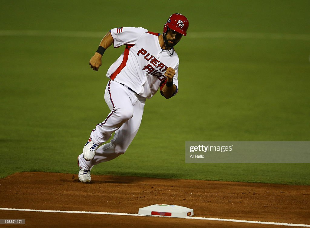 <a gi-track='captionPersonalityLinkClicked' href=/galleries/search?phrase=Angel+Pagan&family=editorial&specificpeople=666596 ng-click='$event.stopPropagation()'>Angel Pagan</a> #16 of Puerto Rico rounds third base on his way to score against Spain during the first round of the World Baseball Classic at Hiram Bithorn Stadium on March 8, 2013 in San Juan, Puerto Rico.