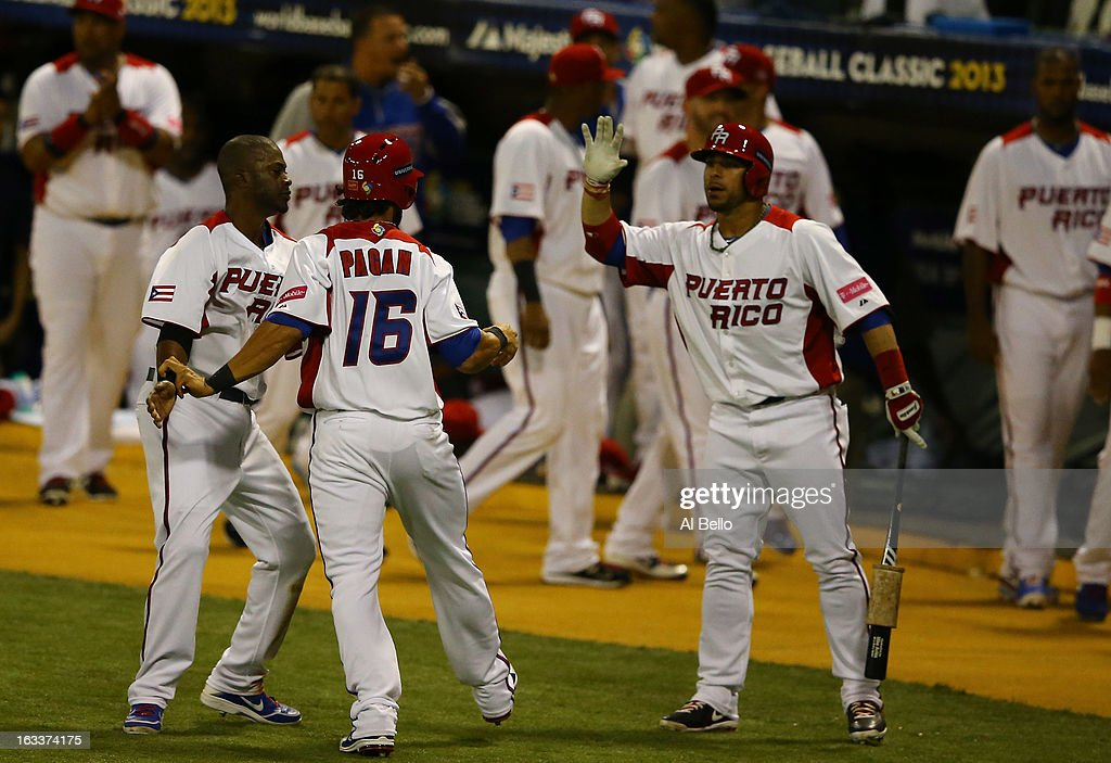 Angel Pagan #16 of Puerto Ricocelerates with teamates after scoring against Spain during the first round of the World Baseball Classic at Hiram Bithorn Stadium on March 8, 2013 in San Juan, Puerto Rico.